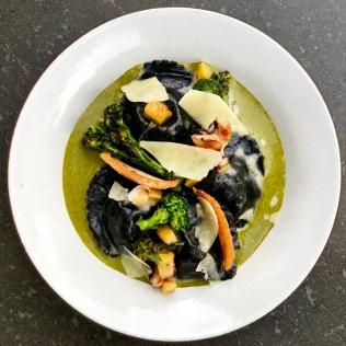 seppia ink and burrata pansotti, broccoli di ciccio crema, charred seppia, delicata e pecorino